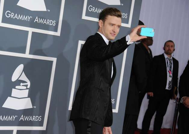 Musician Justin Timberlake arrives at the 55th annual Grammy Awards on Sunday, Feb. 10, 2013, in Los Angeles.  (Photo by Jordan Strauss/Invision/AP) Photo: AP