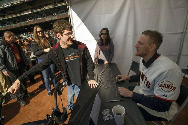 Hunter Pence, meeting fan Matt Fowler, could help his popularity by hitting better than .219. Photo: David Paul Morris, Special To The Chronicle