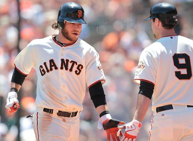 Brandon Crawford is congratulated by Brandon Belt after scoring on a sacrifice fly in the third inning during a game against the A's in San Franicsco, on Sunday, May 20, 2012. The A's won 6-2. Photo: Mathew Sumner, Special To The Chronicle