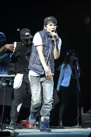 Teen sensation and former San Antonio-area resident Austin Mahone performs at the San Antonio Stock Show & Rodeo, Sunday, Feb. 10, 2013. Mahone became a hit on YouTube and is now a staple on Radio Disney. Photo: JERRY LARA, San Antonio Express-News / © 2013 San Antonio Express-News