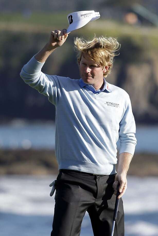 Brandt Snedeker raises his visor on the 18th green of the Pebble Beach Golf Course after winning the AT&T Pebble Beach Pro-Am golf tournament, Sunday, Feb. 10, 2013, in Pebble Beach, Calif. Photo: Eric Risberg, Associated Press