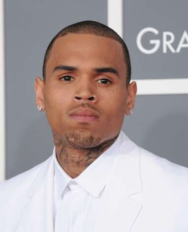 Chris Brown arrives at the 55th annual Grammy Awards on Sunday, Feb. 10, 2013, in Los Angeles.  (Photo by Jordan Strauss/Invision/AP) Photo: Jordan Strauss, Associated Press / Invision