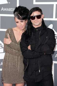 DJ/producer Skrillex (R) and recording artist Sirah arrive at the 55th Annual GRAMMY Awards at Staples Center on February 10, 2013 in Los Angeles, California. Photo: Jason Merritt, Getty Images / 2013 Getty Images
