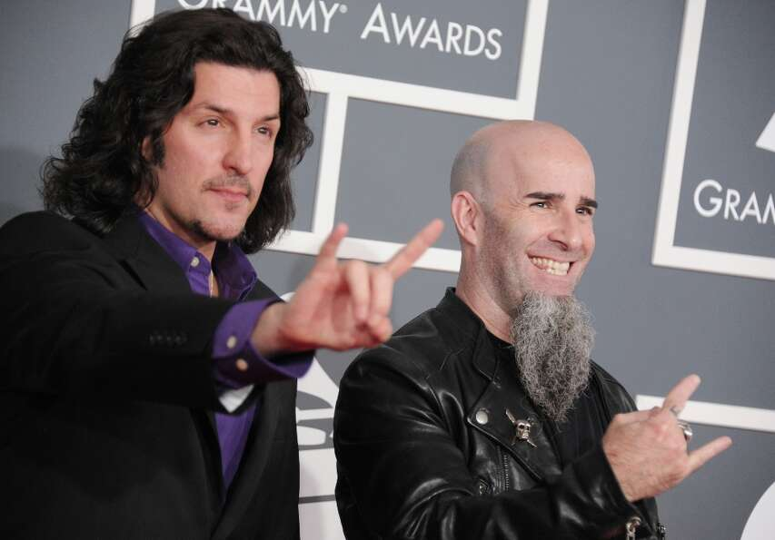 Musicians Frank Bello, left, and Scott Ian, of the musical group Anthrax, arrive at the 55th annual