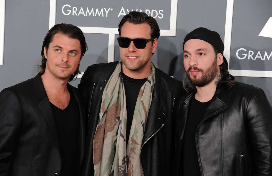 Swedish House Mafia, from left, Axwell, Steve, Sebastian Ingrosso, and Steve Angello arrive at the 55th annual Grammy Awards on Sunday, Feb. 10, 2013, in Los Angeles.  (Photo by Jordan Strauss/Invision/AP) Photo: Jordan Strauss, Associated Press / Invision