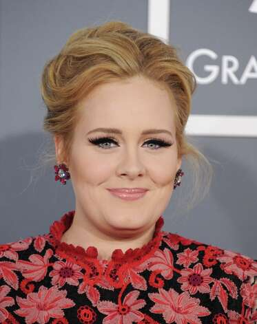 Adele arrives at the 55th annual Grammy Awards on Sunday, Feb. 10, 2013, in Los Angeles.  (Photo by Jordan Strauss/Invision/AP) Photo: Jordan Strauss, Associated Press / Invision