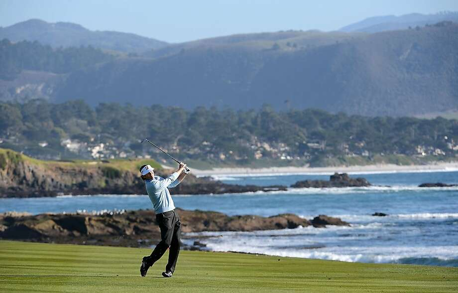 Brandt Snedeker hits his third shot on the 18th hole during the final round of the AT&T Pebble Beach National Pro-Am at Pebble Beach Golf Links on February 10, 2013 in Pebble Beach, California. Photo: Harry How, Getty Images