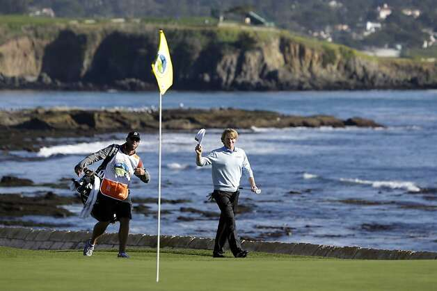 Brandt Snedeker removes his visor as he approaches the 18th green of the Pebble Beach Golf Course during the final round of the AT&T Pebble Beach Pro-Am golf tournament, Sunday, Feb. 10, 2013, in Pebble Beach, Calif. Photo: Eric Risberg, Associated Press