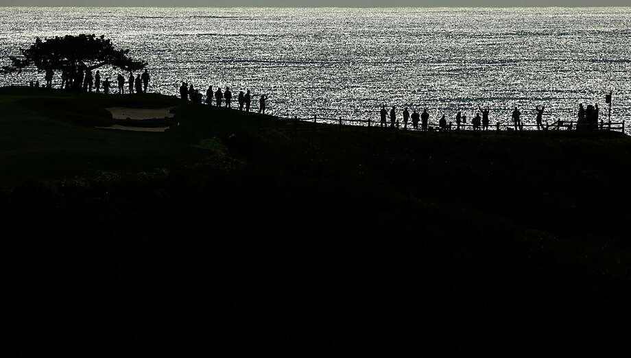 A player watches his tee shot on the seventh hole during the final round of the AT&T Pebble Beach National Pro-Am at Pebble Beach Golf Links on February 10, 2013 in Pebble Beach, California. Photo: Ezra Shaw, Getty Images