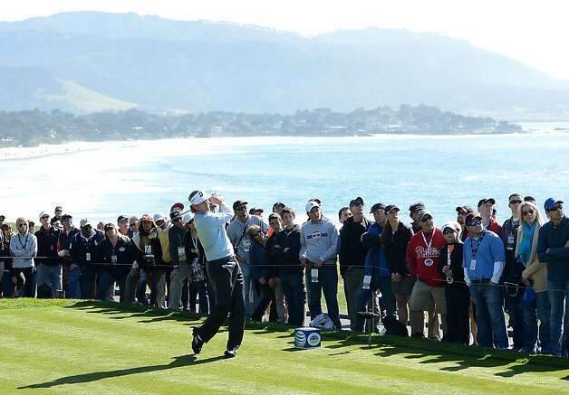 Brandt Snedeker watches his tee shot on the 14th hole during the final round of the AT&T Pebble Beach National Pro-Am at Pebble Beach Golf Links on February 10, 2013 in Pebble Beach, California. Photo: Harry How, Getty Images