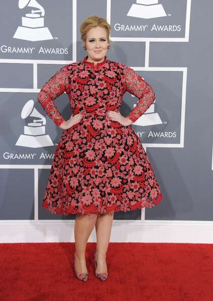 Adele arrives at the 55th annual Grammy Awards on Sunday, Feb. 10, 2013, in Los Angeles.  (Photo by