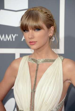 Singer Taylor Swift arrives at the 55th Annual GRAMMY Awards at Staples Center on February 10, 2013 in Los Angeles, California. Photo: Jason Merritt, Getty Images / 2013 Getty Images