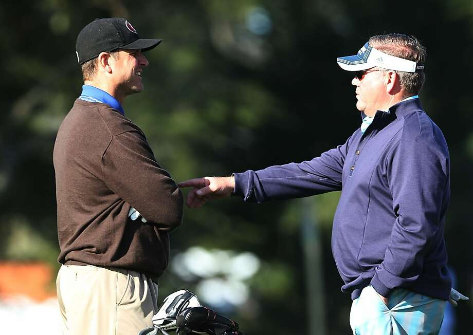 Notre Dame football coach Brian Kelly (R) chats with San Francisco 49ers coach Jim Harbaugh on the second hole during the final round of the AT&T Pebble Beach National Pro-Am at Pebble Beach Golf Links on February 10, 2013 in Pebble Beach, California. Photo: Jeff Gross, Getty Images