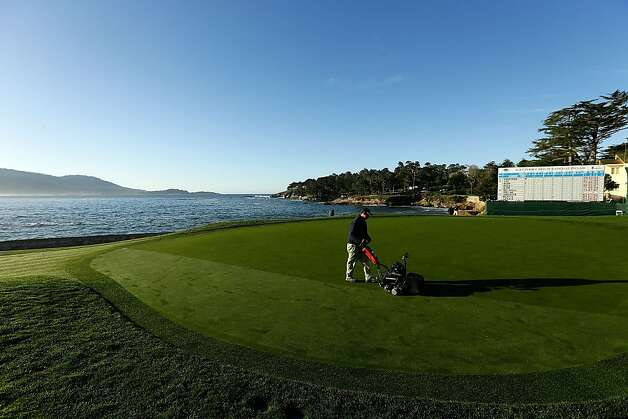 A member of the grounds staff mows the 18th green during the final round of the AT&T Pebble Beach National Pro-Am at Pebble Beach Golf Links on February 10, 2013 in Pebble Beach, California. Photo: Ezra Shaw, Getty Images