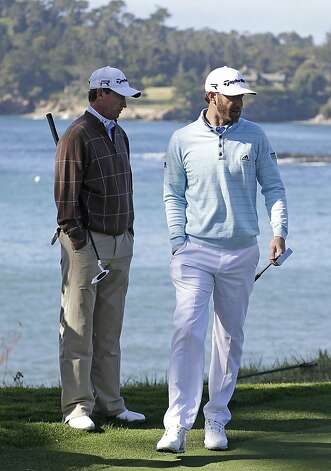 Dustin Johnson, right, and Wayne Gretzky, left, read the fifth green of the Pebble Beach Golf Links during the third round of the AT&T Pebble Beach Pro-Am golf tournament Saturday, Feb. 9, 2013, in Pebble Beach, Calif. Photo: Eric Risberg, Associated Press