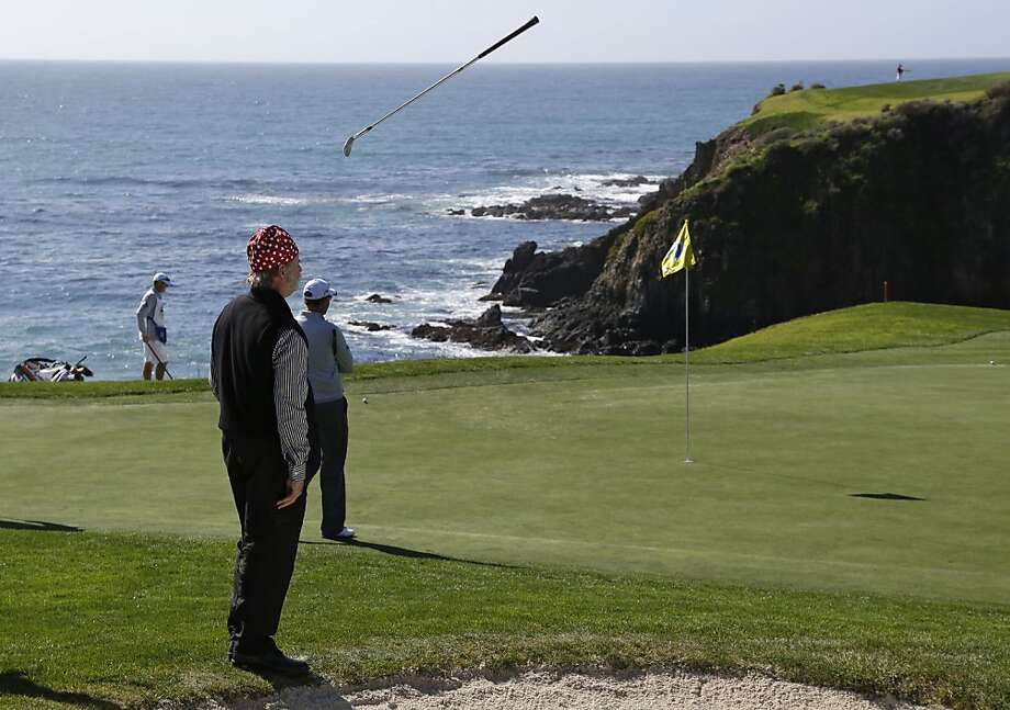 Actor Bill Murray tosses his wedge after chipping onto the eighth green of the Pebble Beach Golf Links during the third round of the AT&T Pebble Beach Pro-Am golf tournament Saturday, Feb. 9, 2013, in Pebble Beach, Calif. Photo: Eric Risberg, Associated Press