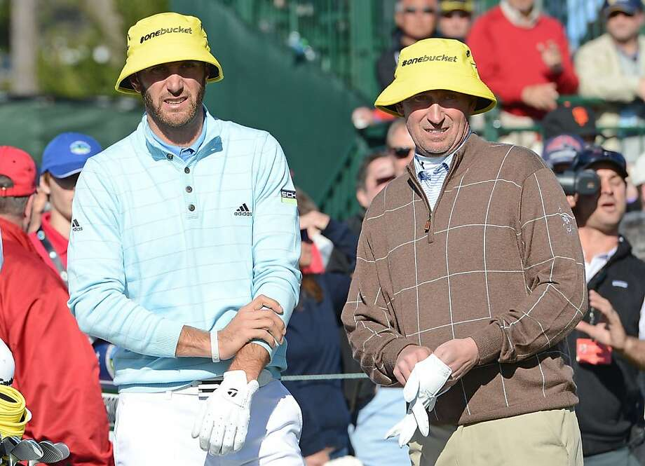 Dustin Johnson (left) and Wayne Gretzky wait on the 17th tee during the third round of the AT&T Pebble Beach National Pro-Am at Pebble Beach Golf Links on February 9, 2013 in Pebble Beach, California. Photo: Harry How, Getty Images