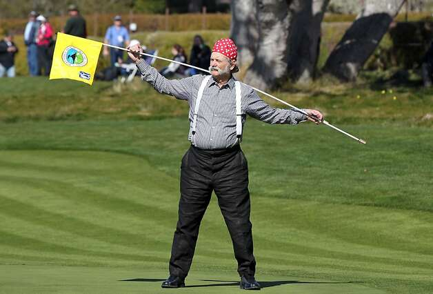 Actor-Comedian Bull Murray clowns around with the pin flag on the 5th hole during the third round of the AT&T Pebble Beach National Pro-Am at Pebble Beach Golf Links on February 9, 2013 in Pebble Beach, Calif. Photo: Lance Iversen, The Chronicle