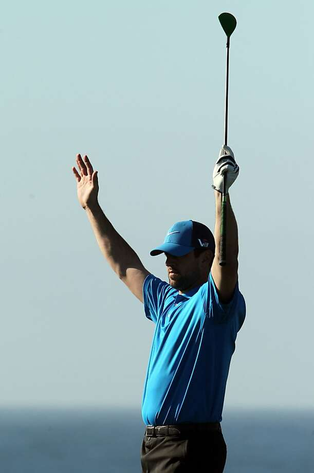 Green Bay Packers quarterback Aaron Rogers indicated a touchdown on the 8th hole during the third round of the AT&T Pebble Beach National Pro-Am at Pebble Beach Golf Links on February 9, 2013 in Pebble Beach, Calif. Photo: Lance Iversen, The Chronicle