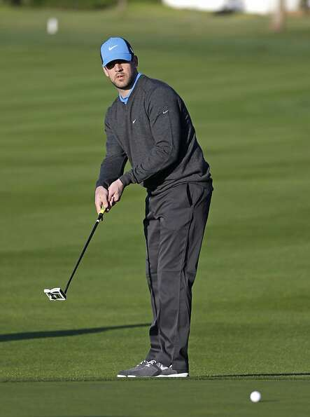 Green Bay Packers quarterback Aaron Rodgers putts on the first green of the Pebble Beach Golf Links