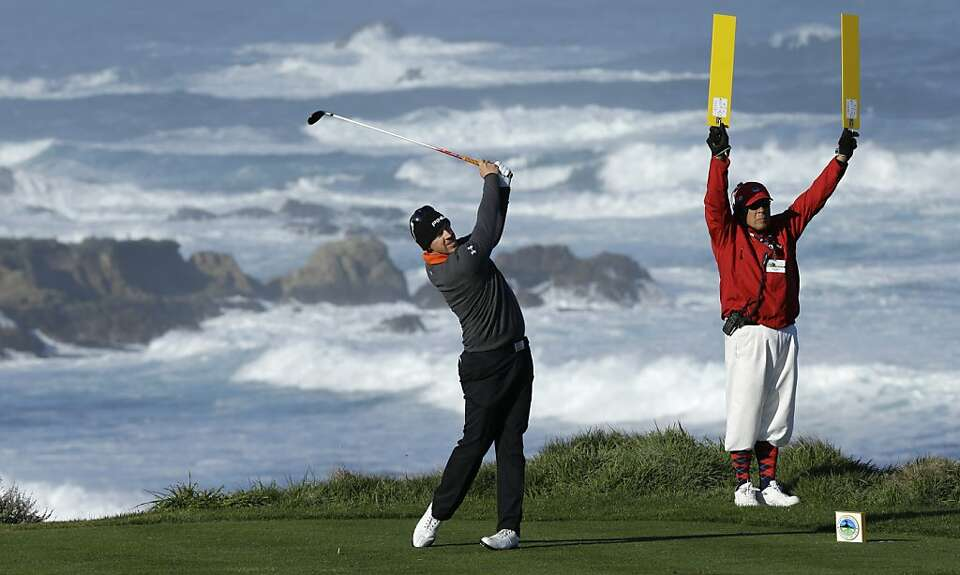 Hunter Mahan hits off the fourth tee on the Spyglass Hill Golf Course during the third round of the