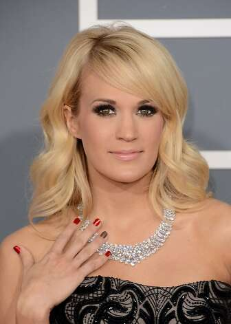 Singer Carrie Underwood arrives at the 55th Annual GRAMMY Awards at Staples Center on February 10, 2013 in Los Angeles, California.  (Photo by Jason Merritt/Getty Images) Photo: Jason Merritt, Getty Images