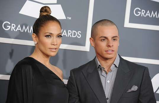 Jennifer Lopez, left, and Casper Smart arrive at the 55th annual Grammy Awards on Sunday, Feb. 10, 2013, in Los Angeles.  (Photo by Jordan Strauss/Invision/AP) Photo: Jordan Strauss, Associated Press