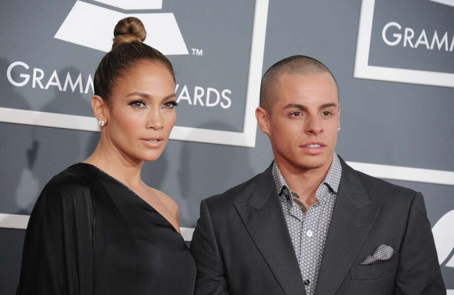 Jennifer Lopez, left, and Casper Smart arrive at the 55th annual Grammy Awards on Sunday, Feb. 10, 2013, in Los Angeles.  (Photo by Jordan Strauss/Invision/AP) Photo: Jordan Strauss, Associated Press / Invision