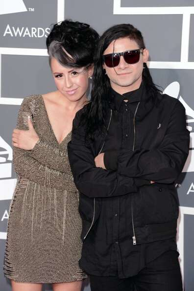 DJ/producer Skrillex (R) and recording artist Sirah arrive at the 55th Annual GRAMMY Awards at Stapl