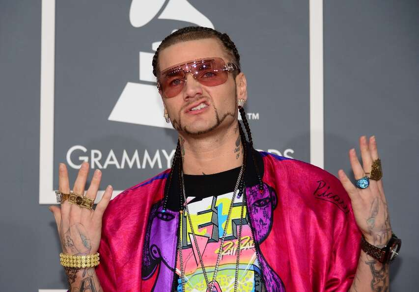 Rapper Riff Raff arrives on the red carpet at the Staples Center for the 55th Grammy Awards in Los A