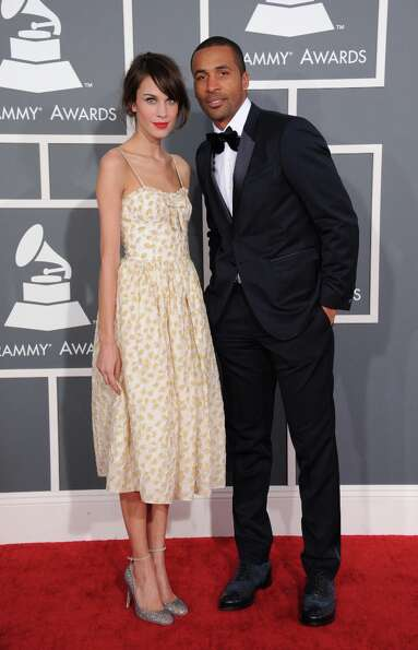 Alexa Chung, left, and Matte Babel arrive at the 55th annual Grammy Awards on Sunday, Feb. 10, 2013,