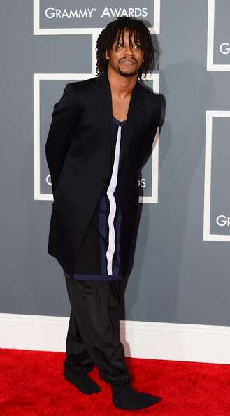 Nominee for Best Rap Album Lupe Fiasco arrives on the red carpet at the Staples Center for the 55th