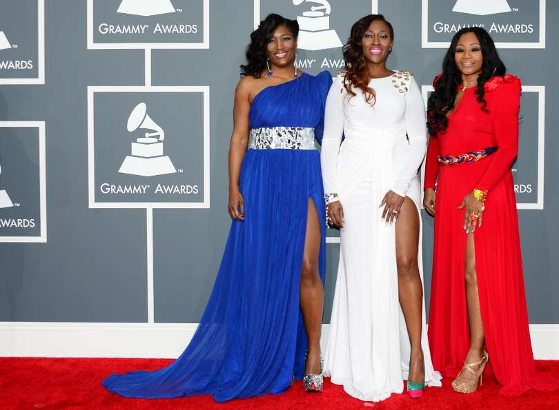 Nominees for Best Traditional R&B Performance SWV arrive on the red carpet with a guest at the Stapl