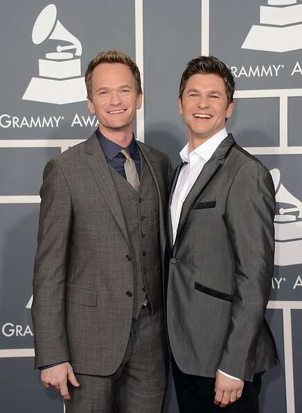 Actor Neil Patrick Harris (L) and David Burtka arrive at the 55th Annual GRAMMY Awards at Staples Ce