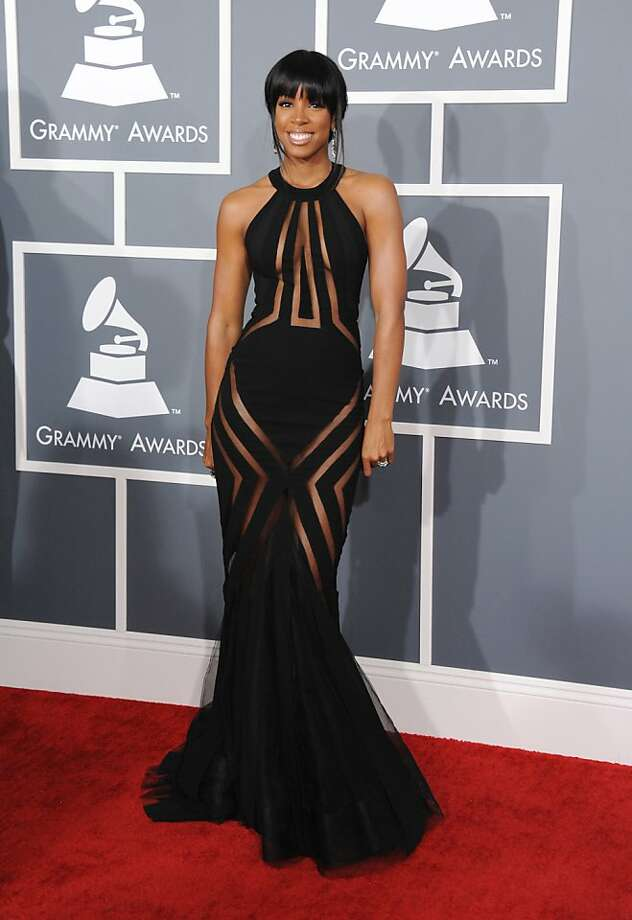 Kelly Rowland arrives at the 55th annual Grammy Awards wearing a dress from the Georges Chakra Couture Collection on Sunday, Feb. 10, 2013, in Los Angeles. (Photo by Jordan Strauss/Invision/AP) Photo: Jordan Strauss, Associated Press