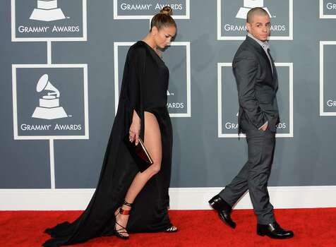 Jennifer Lopez and Casper Smart arrive on the red carpet at the Staples Center for the 55th Grammy Awards in Los Angeles, California, February 10, 2013. AFP PHOTO Frederic J. BROWNFREDERIC J. BROWN/AFP/Getty Images Photo: FREDERIC J. BROWN, AFP/Getty Images / AFP