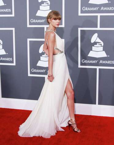 Taylor Swift arrives for the 55th Annual Grammy Awards at Staples Center in Los Angeles, California, on Sunday, February 10, 2013. (Kirk McKoy/Los Angeles Times/MCT) Photo: Kirk McKoy, McClatchy-Tribune News Service / Los Angeles Times