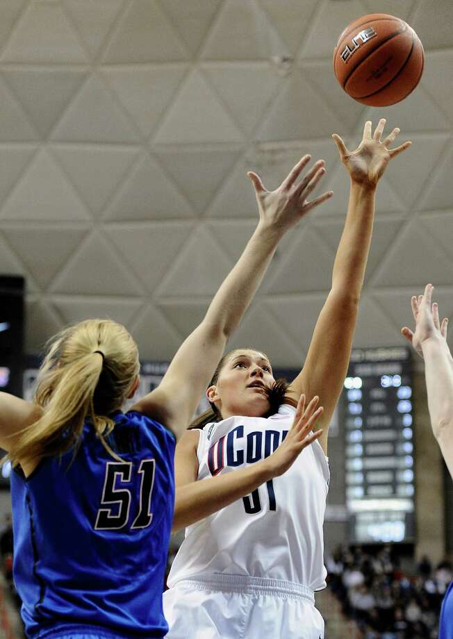Connecticut's Stefanie Dolson, right, goes up for a basket as DePaul's Katherine Harry, left, defends during the first half of an NCAA college basketball game in Storrs, Conn., Sunday, Feb. 10, 2013. Dolson had 22 points in the first half. (AP Photo/Jessica Hill) Photo: Jessica Hill, Associated Press / FR125654 AP