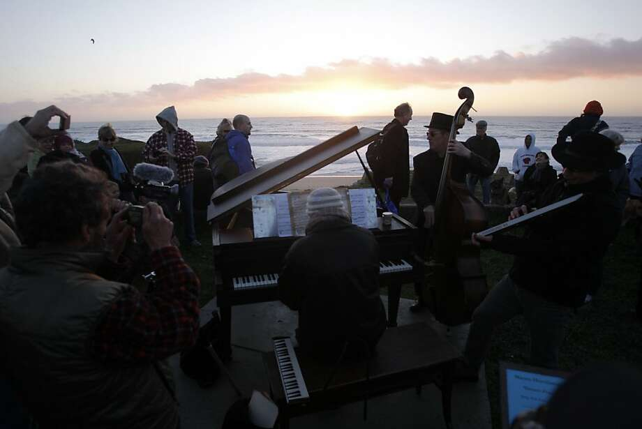 The nightly performance focuses on an old piano as it succumbs to the elements; it'll be removed this week. Photo: Jessica Olthof, The Chronicle