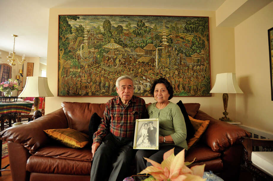 Benny Widyono and his wife, Francisca, display a photograph of themselves on their wedding day, 50 years ago, at their home in Stamford on Monday, Feb. 4, 2013. Photo: Jason Rearick / The News-Times