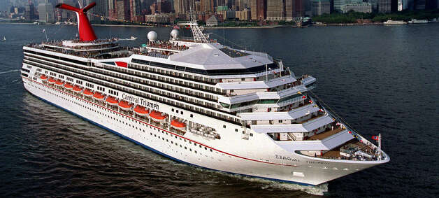Carnival Cruise Lines' newest ship, the MS Carnival Triumph, departs New York harbor, Tuesday, July 27, 1999, on her inaugural voyage to Halifax and St. John's, Nova Scotia. The vessel, which is as large as two football fields and can carry as many as 3,473 passengers, will sail from New York through October 11 and then commence Caribbean cruises from Miami October 23. Photo: ANDY NEWMAN, AP / CARNIVAL CRUISE LINES