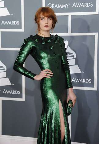 Florence Welch, of Florence and the Machine, arrives at the 55th annual Grammy Awards on Sunday, Feb. 10, 2013, in Los Angeles.  (Photo by Jordan Strauss/Invision/AP) Photo: AP