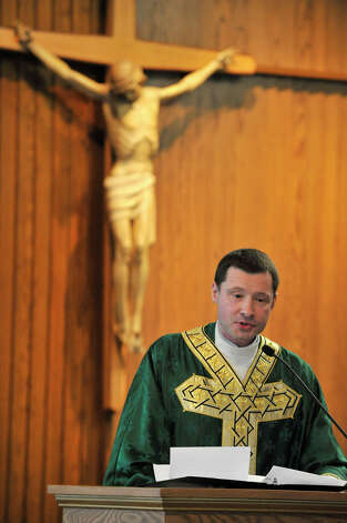 Father Les Szymaszek speaks during the Anniversary Mass at St. Leo Catholic Church in Stamford on Sunday, Feb. 10, 2013. Photo: Jason Rearick / The News-Times