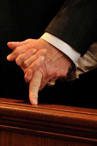 Chris Munger, left, and Marge Munger hold hands during the Anniversary Mass at St. Leo Catholic Church in Stamford on Sunday, Feb. 10, 2013. The Mungers will be celebrating their 50-year wedding anniversary this November. Photo: Jason Rearick / The News-Times