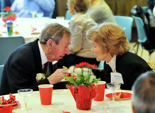 William and Barbara Symanko talk to each other during the reception after the Anniversary Mass at St. Leo Catholic Church in Stamford on Sunday, Feb. 10, 2013. The Symankos will be celebrating their 65-year wedding anniversary this November. Photo: Jason Rearick / The News-Times