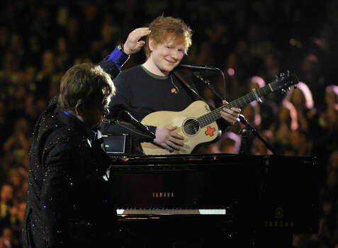 Sir Elton John, left, and Ed Sheeran perform on stage at the 55th annual Grammy Awards on Sunday, Feb. 10, 2013, in Los Angeles. Photo: John Shearer, Associated Press / Invision