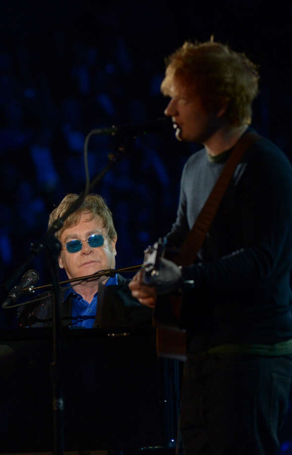 Elton John and Ed Sheeran perform at the Staples Center during the 55th Grammy Awards in Los Angeles, California, February 10, 2013. Photo: JOE KLAMAR, AFP/Getty Images / AFP