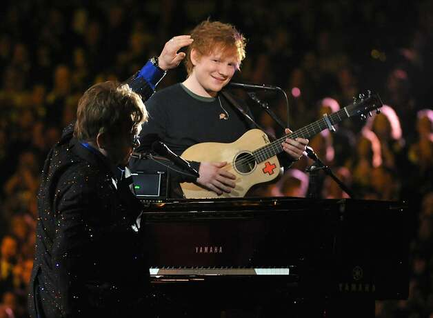 "Ed Sheeran and Elton John perform ""The A-Team"" It seemed like LL Cool J's cliche-ridden opening monologue would never end. Thank goodness for young, red-haired British singer-songwriter Sheeran, who, with John on the piano and backing vocals, provided a moment of low-key clarity early in the evening with his melancholy hit, ""The A-Team,"" which was nominated for song of the year. We can't remember the last time we were more relieved to hear a tune about a drug-addicted teen prostitute.  Photo: John Shearer"