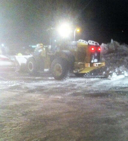 Payloaders and plow vehicles were deployed late Sunday to clean the parking lots at the downtown Fairfield Railroad Station after Metro-North Railroad announced it would resume service Monday morning after it was suspended Friday as the blizzard closed in.  FAIRFIELD CITIZEN, CT 2/10/13 Photo: John Schwing / Fairfield Citizen contributed