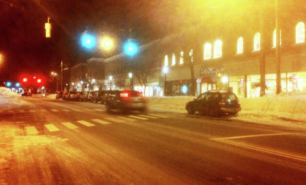 Lights -- and life -- slowly returned to downtown Fairfield on Sunday night, two days after a blizzard shut down most businesses Friday afternoon.  FAIRFIELD CITIZEN, CT 2/10/13 Photo: John Schwing / Fairfield Citizen contributed